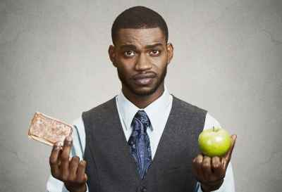 man-holding-pastry-and-apple