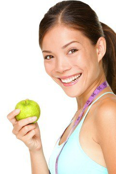 woman-holding-apple-with-tape-measure-around-neck