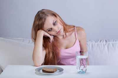 starving-girl-looking-at-toast