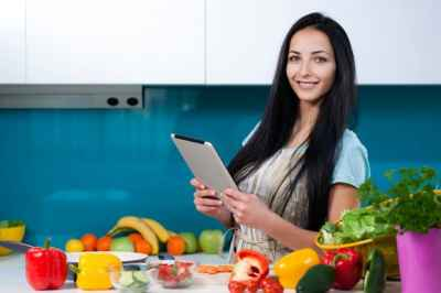woman-on-tablet-in-kitchen-with-fruits-and-vegetables-1