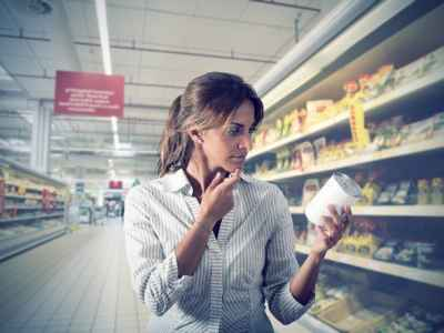 brunette-questioning-whether-canned-food-is-healthy