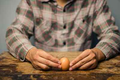 hands-holding-boiled-egg