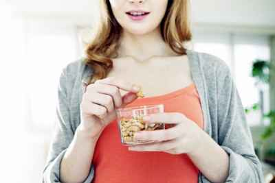 young-woman-snacking-on-cashews