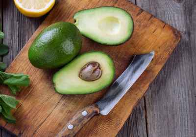 two-avocados-on-chopping-board