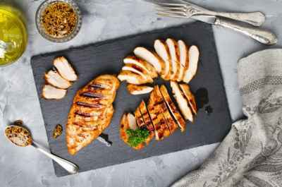 two-pieces-chicken-on-stone-chopping-board