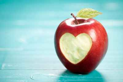 apple-with-heart-on-turquoise-table