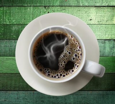 coffee-cup-on-green-table1-e1416607247642-480x437
