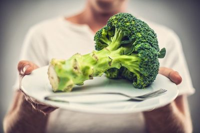 holding-broccoli-on-a-plate