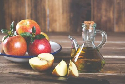 glass-jug-apple-cider-vinegar-and-plate-with-apples