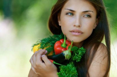 young-brunette-holding-fresh-vegetables-1