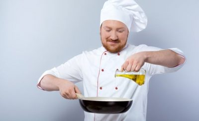 chef-pouring-oil-into-pan