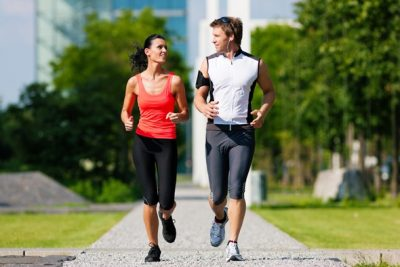 couple-running-in-city