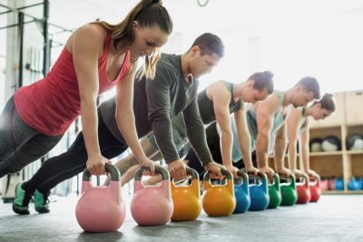 five-people-using-kettle-bells-for-resistance-training