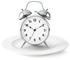 silver-alarm-clock-on-plate