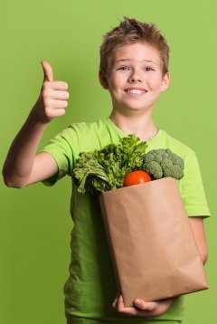 excited-child-holding-groceries
