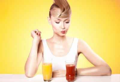 woman-pursing-lips-at-juice