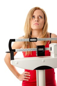 woman-standing-on-the-scale-frustrated1 (1)