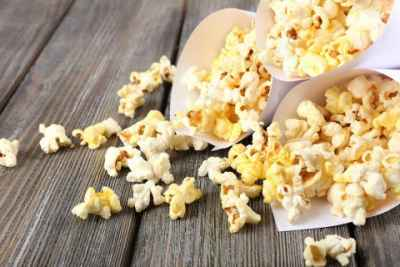 bigstock-Popcorn-on-wooden-table-close-68726650-480x320