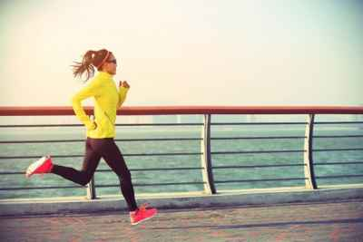 young-woman-running-by-seaside