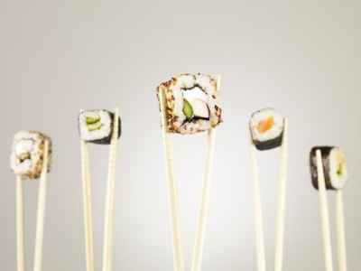 sushi-held-by-chopsticks