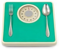 fork-and-knife-on-green-scales