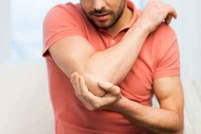 man-with-elbow-joint-pain