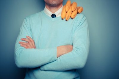 man-with-bunch-of-bananas-on-his-shoulder