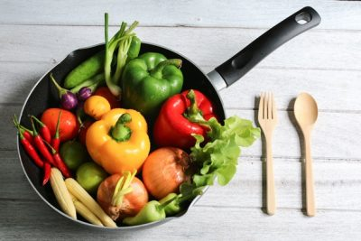raw-bell-peppers-onions-and-other-veggies-in-a-pan