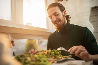 young-man-enjoying-a-healthy-meal