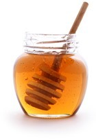 open-jar-of-honey