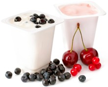 two-pots-of-yogurt-and-some-berries