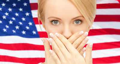 usa politics, conspiracy and secrecy concept - woman with hands over mouth on american flag background